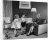 1950s Little Boy And Girl Son And Daughter Giving Woman Mother Sitting In Living Room A Gift Present by Corbis