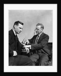 1930s Man Doctor Taking Pulse Of Man Patient by Corbis