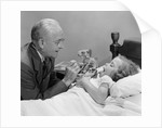 1950s Little Girl Sick In Bed Sticking Out Her Tongue for Doctor by Corbis