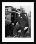 1930s Man In Suit And Hat Holding Gloves Stepping Into Automobile Driver Seat by Corbis