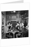 1930s Two Couples Sitting Inside Camping Trailer Eating Lunch by Corbis