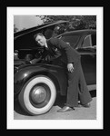 1939 1940s Man Wearing Suit And Tie Checking Engine Under Automobile Hood by Corbis