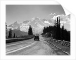 1930s Sedan Automobile Driving High Mountain Road Towards Snow Capped Mount Rainier Washington State Usa by Corbis