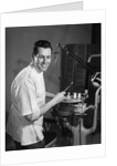 1960s Portrait Man Professional Dentist Holding Dental Tool Mirror by Corbis