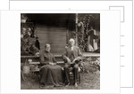 1890s 1900s Portrait Senior Couple Seated In Garden Man Holding Ear Trumpet by Corbis