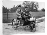 1900s Two Men In Bowler Hats Sitting In Three Wheel Motorized Horseless Carriage by Corbis