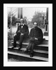 1890s 1900 Two Bearded Men In Suits Holding Bowler Hats Sitting On Stairs In Front Of House by Corbis
