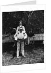 1900 Man Smoking Cigar Carrying Wife Piggyback by Corbis
