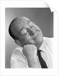 1950s 1960s Balding Man Leaning Head On Fist In Shirt And Tie Eyes Closed Thinking Expression by Corbis