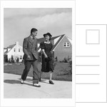 1940s Teenage Couple Walking On Suburban Sidewalk by Corbis