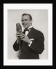 1920s 1930s Man Radio Singer Entertainer Crooner In Tuxedo Singing Into Microphone by Corbis