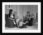 1960s Family Mother Father Son Daughter Watching Television In Living Room Indoor by Corbis