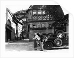 1930s Tourist Couple By Car Looking At Map In Front Of Eisenach Lutherhaus 1563 Where Luther Lived While Attending School by Corbis