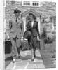 1930s 1940s Couple Leaving Home Carrying Luggage by Corbis