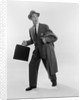 1950s Surprised Businessman Holding Briefcase Taking A Step Forward Looking Back by Corbis