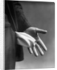 1930s Man's Hand Turning Empty Pants Pocket Inside Out by Corbis