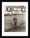 1950s Executive In Gray Flannel Suit And Tie Standing On Suburban Home Lawn by Corbis