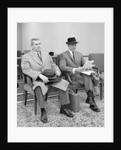 1950s 1960s Two Men Businessman Salesman Sitting In Office Reception Waiting Area Indoor by Corbis