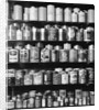 1930s 1940s Tin Cans And Containers On Shelves by Corbis