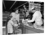 1960s Mother Daughter Unload Grocery Cart At Supermarket Checkout Counter by Corbis