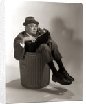 1960s Fired Businessman Sitting In Trash Can by Corbis