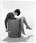 1960s Young Woman In Trash Can by Corbis