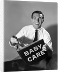 1960s Man Father Holding Baby Care Book by Corbis