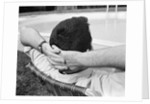 1970s Man With Hands Folded Behind Head Stretched Out In Lounge Chair Poolside by Corbis