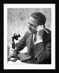 1920s Businessman Talking Into Candlestick Telephone by Corbis