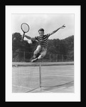 1930s Teenage Boy Tennis Player Jumping Net With Racket In Hand by Corbis