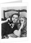 1930s Young Brunette Woman Reclining On Pillows Cigarette In Hand Talking On Telephone by Corbis
