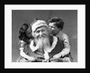 1930s Man Santa Claus Posing With Boy And Girl Whispering In His Ears by Corbis