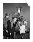 1960s Boys Singing Christmas Carol Together Standing By Outdoor Porch Light by Corbis