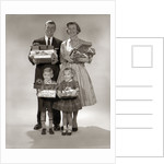 1950s 1950s Family Carrying Christmas Gifts Wrapped Presents by Corbis