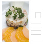 Crab and tropical fruit timbale with endive, melon and orange at The Sugar Mill, Tortola, British Virgin Islands by Corbis