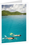 Couple Snorkeling in Hawksnest Bay at St. John Island by Corbis