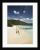 Couple Walking on a Sandy Beach by Corbis