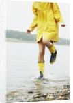 Woman Splashing in Lake by Corbis