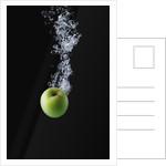 Green Apple in Water by Corbis
