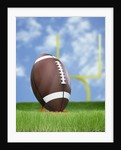 Football and field goal by Corbis