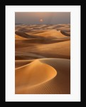 Sunset over the sand dunes in Dubai by Corbis