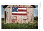 American flag painted on barn by Corbis