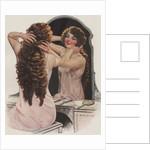 Brunette fixing hair in mirror by Corbis