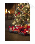 Christmas tree by fireplace by Corbis