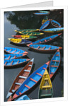 Canoes floating on water by Corbis