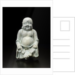Sculpture of happy Buddha by Corbis