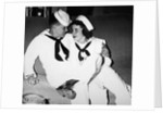 """A sailor poses with his""""sailor"""" girlfriend at a party, ca. 1955 by Corbis"""