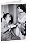 A couple exchange engagement gifts, ca. 1955 by Corbis