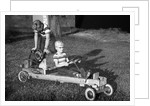 Brothers play with their homemade go cart, ca. 1955 by Corbis