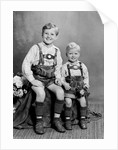 Two brothers pose for a childhood portrait in Germany, ca. 1949 by Corbis